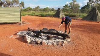 Our camp and our guide cooking Kangaroo meat